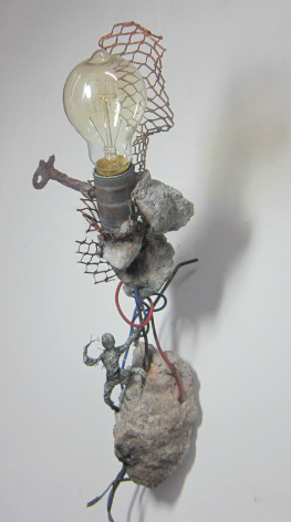 Concrete, steel, epoxy clay, and electrical part.