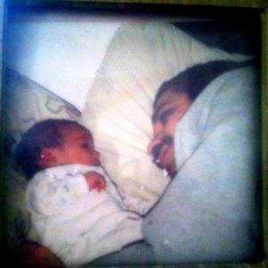My daughter as a newborn and me.