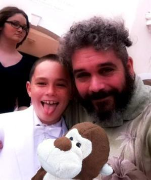 My grandnephew dressed up like a pimp for his First Communion. We got photobombed by my daughter.....